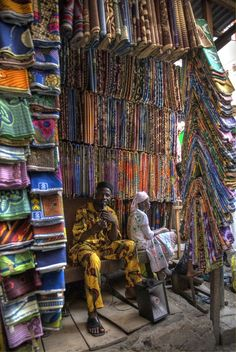 I've been to Jos Nigeria and saw bought fabric . this picture is a Textile Vendor in Lagos, Nigeria We Are The World, People Around The World, Around The Worlds, Out Of Africa, West Africa, South Africa, African Textiles, African Fabric, Ankara Fabric