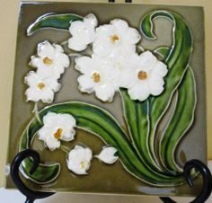 What a great tile from Maw & Co., one of the classic makers of tiles in the Art Nouveau period. The tile measures x and I believe the flowers are narcissus. Antique Tiles, Vintage Tile, Art Deco Flowers, Craftsman Tile, Narcissus Flower, Art Nouveau Tiles, Rookwood Pottery, Art Tiles, Mosaic Patterns
