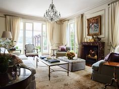 For the formal sitting room, Hamel recovered the owners' existing furnishings using fabrics by Lelievre, Rogers & Goffigon, Kerry Joyce, and Schumacher. He sourced the Turkish rug in Istanbul and custom made the cocktail table   archdigest.com