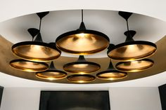 A lighting cluster of Tom Dixon's Beat wide pendants in the Metropolitan Wharf interior.