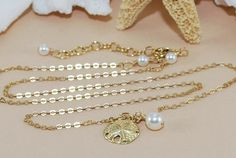 Hey, I found this really awesome Etsy listing at http://www.etsy.com/listing/159553166/sand-dollar-pearl-necklace-bridesmaid