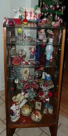 Display case of antique Christmas  http://www.hometraditions.com/antique_christmas_in_new_jersey_s/1950.htm