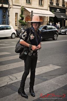 Men's style on the streets of Paris - Rock and Roll look - Boots jeans, leather bags, Asian motif blouson, beads, earing, felt hat. Photographed at Paris-Vendôme by Kent Johnson for Street Fashion Sydney.
