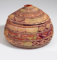 Africa | Basket with lid; probably from Ethiopia | Plant fiber, dye and hide | ca. 1912.