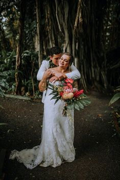 Obsessed with this Tropical Hawaii Wedding at Haiku Gardens Wedding Venue in Oahu. After the whimsical wedding ceremony, we snuck out for some bride and groom photos in the lush green jungle! The brides elegant lace wedding dress and the grooms all white grooms suit looked beautiful with the tropical floral details - Hawaii Wedding Photographer Wedding Groom, Wedding Ceremony, Lace Wedding, Dream Wedding, Wedding Dress, Maui Weddings, Hawaii Wedding, Whimsical Wedding Inspiration, Maui Wedding Photographer