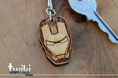 Laser cut and engraved Ironman Mask wood keyring. By TwikiConcept on Etsy
