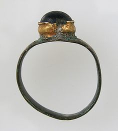 Finger Ring Date: 7th century Geography: Made in Northern France Culture: Frankish Medium: Copper alloy, gilding, gold, glass paste cabochon...