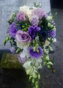 Traditional teardrop trailing shower bouquet--love the shape