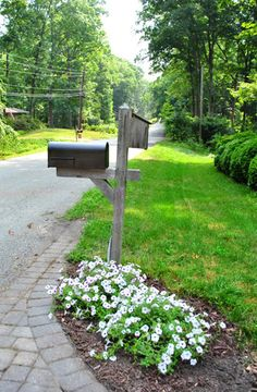 Although we do not have driveway delivery mailboxes, this is SOO cute! maybe i'll add some flowers to the end of the driveway?