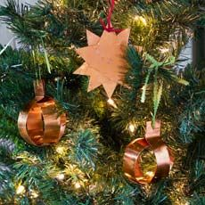 copper ornaments you can make for DIY gifts hanging on a Christmas treet