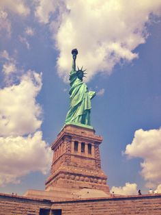 Visit the Statue of Liberty!!! I really want a pic with it!!!