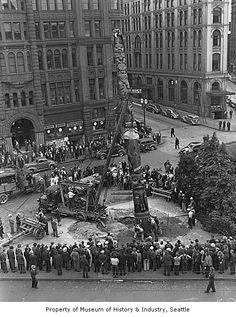 Reinstalling Seattle totem pole in Pioneer Square, Seattle, July 24, 1940