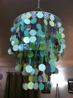 We could get fancy schmancy scrapbook paper in colors you like and make this chandelier to cover the less than fabulous light fixture in the bed room.would also make a great party decoration! Paper Chandelier, Paper Lampshade, Brass Chandelier, Chandeliers, Circle Chandelier, Chandelier Lighting, Origami Lamps, Bedroom Ideas For Teen Girls, Bricolage
