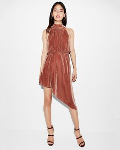 An effortlessly sexy dress that flaunts your figure with smooth velvet, a deep v-back and a romantic asymmetrical skirt. Pair with heels to hit the town in chic style.