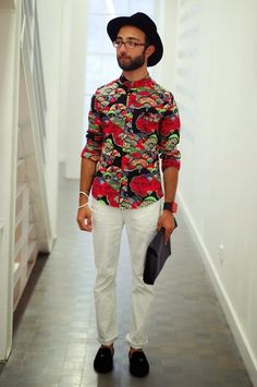 Shop this look for $181:  http://lookastic.com/men/looks/hat-and-longsleeve-shirt-and-chinos-and-tassel-loafers-and-zip-pouch/3420  — Black Hat  — Red Print Longsleeve Shirt  — White Chinos  — Black Suede Tassel Loafers  — Black Leather Zip Pouch