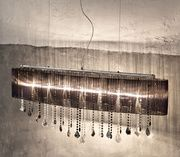 The absolutely stunning Paralume Fantasy chandelier. This show stopping light features Swarovski Elements crystals at varying heights. A show stopping piece that makes any room sparkle.