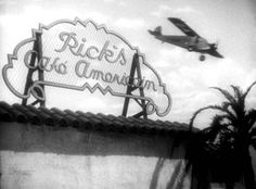 Casablanca (1942) photo from the film showing the airplane used to leave Casablanca is shown flying over the sign to Rick's Café Americain (that will be used later by Ilsa and Victor using the Letters of Transit Rick got from Ugarte earlier in the film).