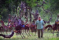 "Tom Every walks through his bird sculpture garden near ""The Forevertron."" The whimsical birds are made up of musical instruments and other industrial salvage."
