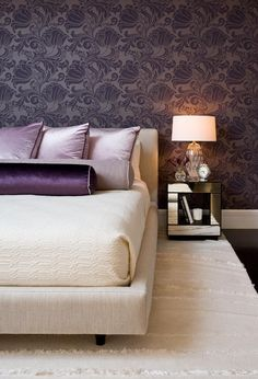 Sophisticated use of eggplant  purple in the bedroom.  Daun Curry