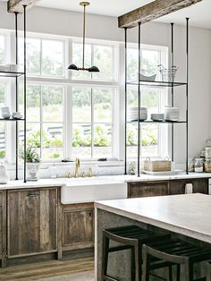 Here's a Bright Storage Idea: Extend Your Open Shelving Across the Kitchen Windows
