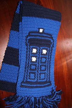 It makes an adult-sized scarf. I recommend Loops and Threads yarn based on the colors, but it isn't really a requirement. It uses less than one oz skein of each color (navy, royal, and clear blue) and less than 3 yards of white. Crochet Tardis, Doctor Who Crochet, Crochet Geek, Crochet Cross, Free Crochet, Knit Crochet, Crochet Hats, Crochet Potholders, Knit Cowl