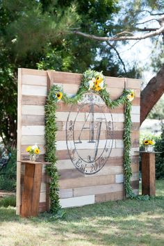 eucalyptus garland ceremony backdrop with sunflower ceremony arrangements and sunflower mason jar aisle arrangements! Emlily Floral   Barn Wedding at Strathearn Park Simi Valley