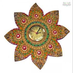 Some really unique wall clocks are available online and this one makes for a collector's item for sure! This harnesses exquisite paper mache techniques to come with its Rajasthani Turban Man theme. The multicolor combination adds to its exotic appeal. This clock is wooden base it is made of chalk, soil and paper.