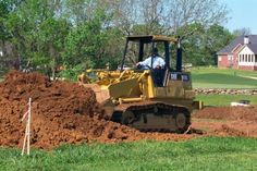 Bring in fill dirt to grade your lawn to a proper slope and reduce drainage issues.