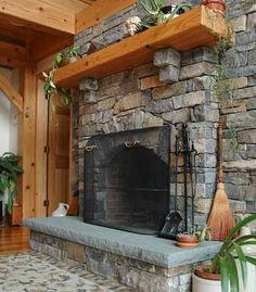 Like the mix of stone and wood. Would choose different stone and darker wood, but good mixture nonetheless. Like how the mantle extends beyond and around corners of the stone fireplace.