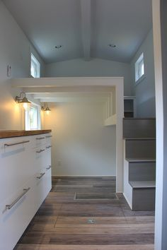 A 198 square feet tiny home with underfloor storage feature built by Brevard…