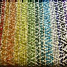 Nicole's Weaving Art- multicolored warp threads with a white weft.  Bench seat cover perhaps.