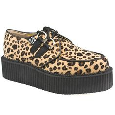 T.U.K Mondo Hi Sole Creeper Chunky soled creepers from T.U.K. This leopard s got spots with a patterned man made upper and 2 tie D ring lace feature. Hefty sole unit with a height of 5cm to finish http://www.comparestoreprices.co.uk/womens-shoes/t-u-k-mondo-hi-sole-creeper.asp