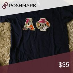 Alpha Phi Letters Only worn once or twice. The fabric is very soft and there are no flaws whatsoever. Sorry the picture quality is not very good, let me know and I will take some more pictures if you'd like. Navy vneck with floral letter design American Apparel Tops Tees - Short Sleeve
