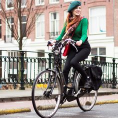 Get this look: http://lb.nu/look/8095244  More looks by Sonja Vogel: http://lb.nu/retrosonja  Items in this look:  Levi's® High Waisted Black Jeans, Tamaris Ankle Boots   #preppy #retro #street #dutch #amsterdam #bike #biking #rainy #hat