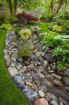 If your property has some serious water drainage issues and no way to neatly guiding it away from your house, then try expanding the scale of a dry creek bed idea. Same rules apply, but having a massive dry creek river will surely handle the abundant water flow.