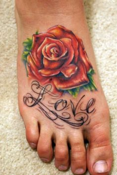 Rose foot tattoo with one on each foot and family names under each.