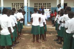 Children learn about the dangers of Ebola in school.