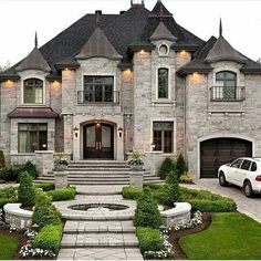 A Victorian House made of stone!!! Bebe'!!! I love the landscaping at this house!!!