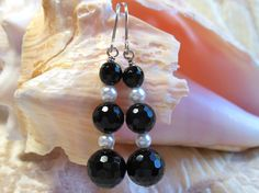 Onyx and pearl earrings, black and white, black faceted onyx with white pearls, argentium sterling silver earring wires, great for holidays by #EyeCandybyCathy on Etsy