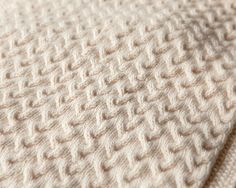 Snuggly Cables Baby Blanket | Your little one will love snuggling with this cozy knit baby blanket.