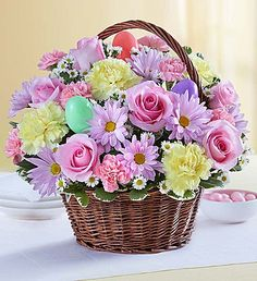 Easter Egg Basket™    Send Easter smiles by the basketful! We've taken the freshest blooms in pastel shades of pink, yellow and lavender, and gathered them inside a rustic basket with colorful Easter eggs for a lovely surprise. Send our charming bouquet as a gift for the holiday hostess, and it's sure to be a special delight!