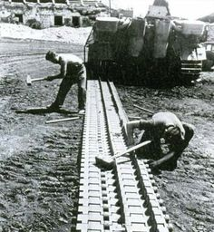 Maintenance crews rebuilding the track section to this Panther tank