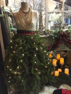 I'm over the moon over this girl!  Our front window at Sister to Sister in Prosser, Washington. A romantical  Christmas garland on a vintage dress form. Simply beautiful.