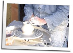 A craftsman turns a pot in the Blue Ox pottery shed