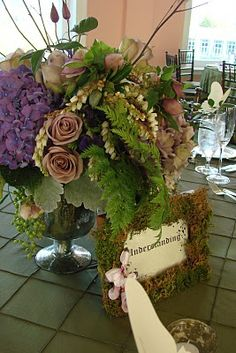 Enchanted Forest Theme; i like the different flowers but could replace the pink/purple roses and hydrangeas with white ones