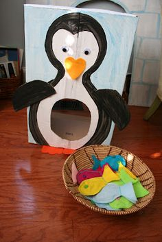 Penguin Toss. I just like the general idea. I want to build some sort of box with an open bottom to attach to the wall that the kids can throw stuff into the mouth of for fun.