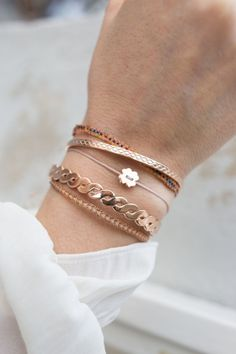 Rose gold plated bangles in combination with textile and handmade Guanabana…