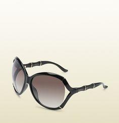 gafas de sol de montura oval extragrande con efecto bambú y el logotipo de gucci en patillas.