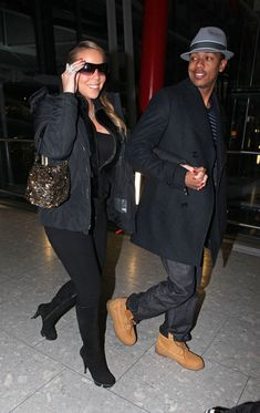 Mariah Carey Photos - Mariah Carey, 39, and her husband Nick Cannon, 29, prepare for departure from Heathrow airport. - Mariah Carey and Nick Cannon Leave from Heathrow Airport