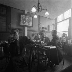 """1950's. A peak inside journalist café Scheltema at the Nieuwezijds Voorburgwal in Amsterdam. In the 1950's and 1960's the Nieuwezijds Voorburgwal was often called the """"Fleet Street"""" of The Netherlands because so many editorial offices and printing facilities of Dutch national newspaper were operated from the street. Photo MAI Beeldbank. #amsterdam #1950 #Scheltema #NieuwezijdsVoorburgwal"""